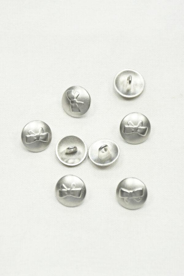 Пуговица маленькая металл серебро с выбитым бантиком 3