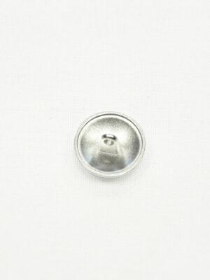 Пуговица металл серебро с выбитым бантиком 1