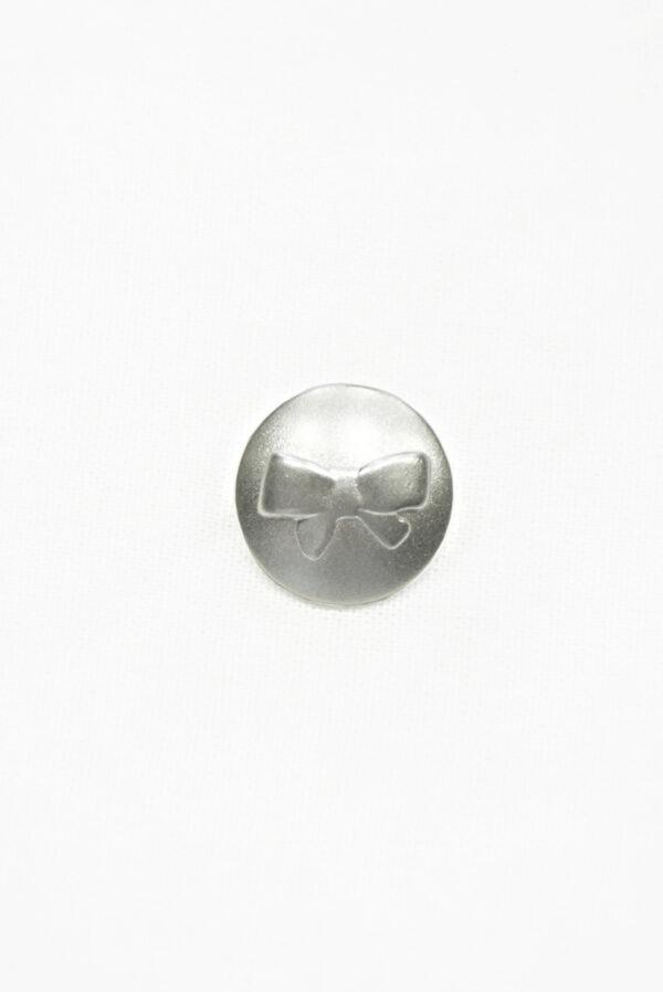 Пуговица металл серебро с выбитым бантиком