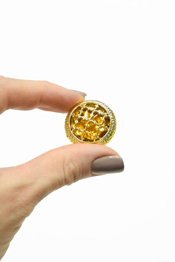 Пуговица пластик золотая с янтарным кристаллом 3