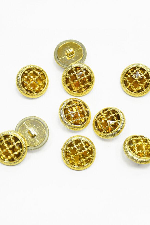Пуговица пластик золотая с янтарным кристаллом 2