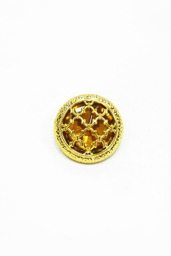 Пуговица пластик золотая с янтарным кристаллом