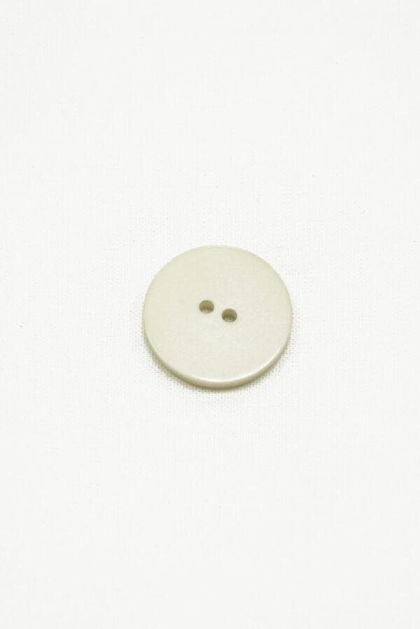 Пластиковая круглая пуговица на прокол серо-бежевого цвета с необычным рисунком в виде чешуек1