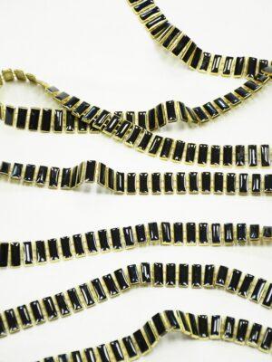 Тесьма золотая с черными эмалированными камнями