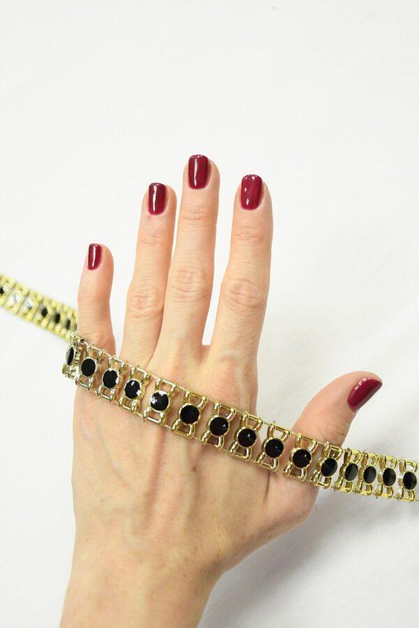 Тесьма с черными эмалированными камнями в золотой оправе 1