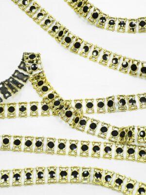 Тесьма с черными эмалированными камнями в золотой оправе