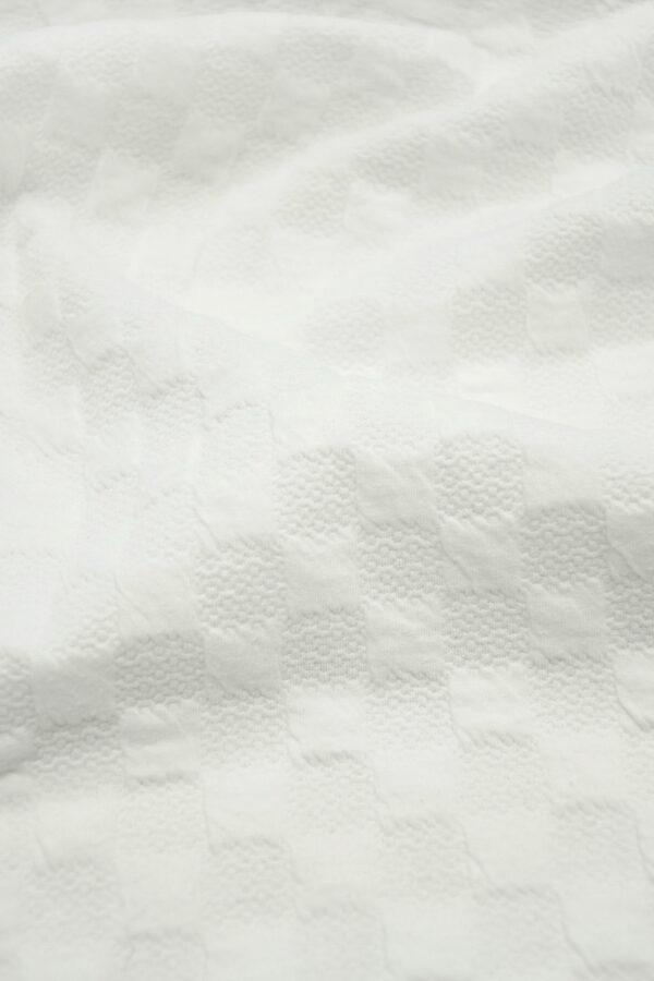 Джерси молочно-белый в фактурную клетку 4