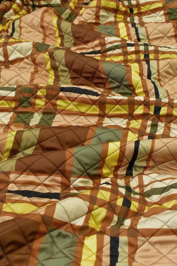 Курточная на шерстепоне стежка клетка в теплой гамме